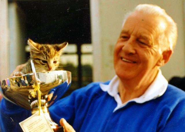 Jolly man holding a kitten